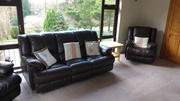 Three piece leather recliner suite .